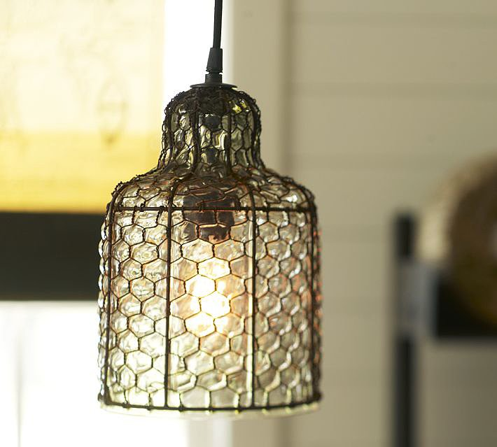 Honeycomb lighting, anyone? Handblown glass is fitted into an iron  farm-wire frame to make this Harlowe Wire and Glass Pendant ($99).