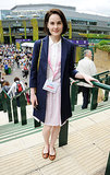 It's not a stretch to envision the Downton crew enjoying a spot of tennis. Michelle Dockery, aka Lady Mary, took in the scene in a pale pink dress and navy topper.