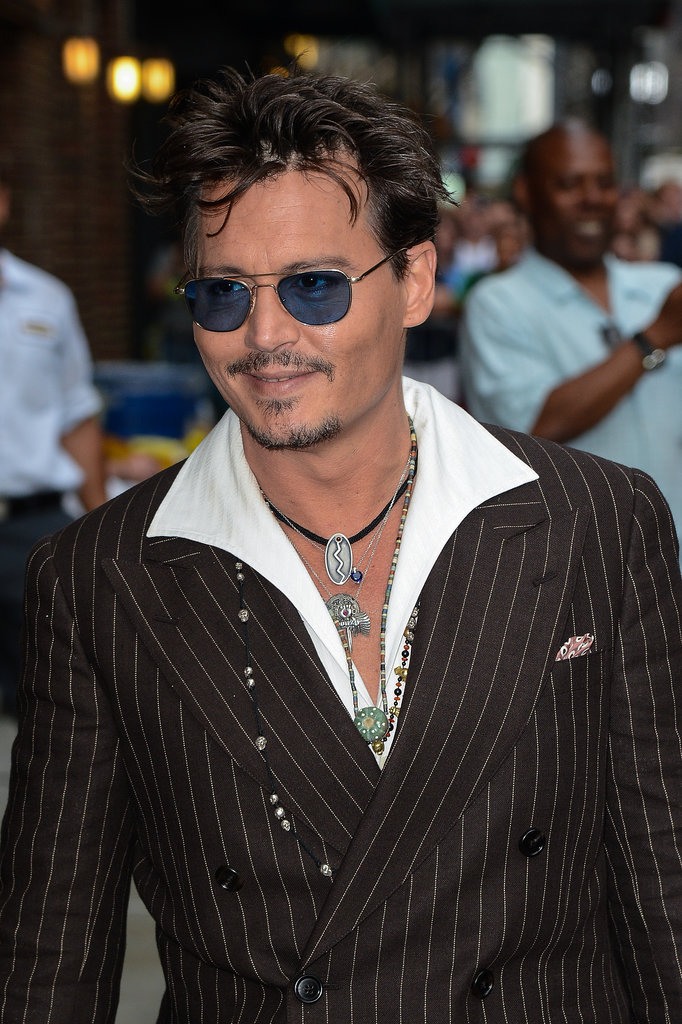 Johnny Depp gave his fans a smile in NYC.