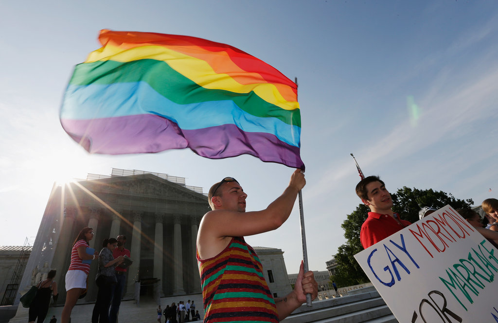 Gay rights activists took to the steps of the US Supreme Court in Washington DC to celebrate the DOMA and Prop 8 victories.