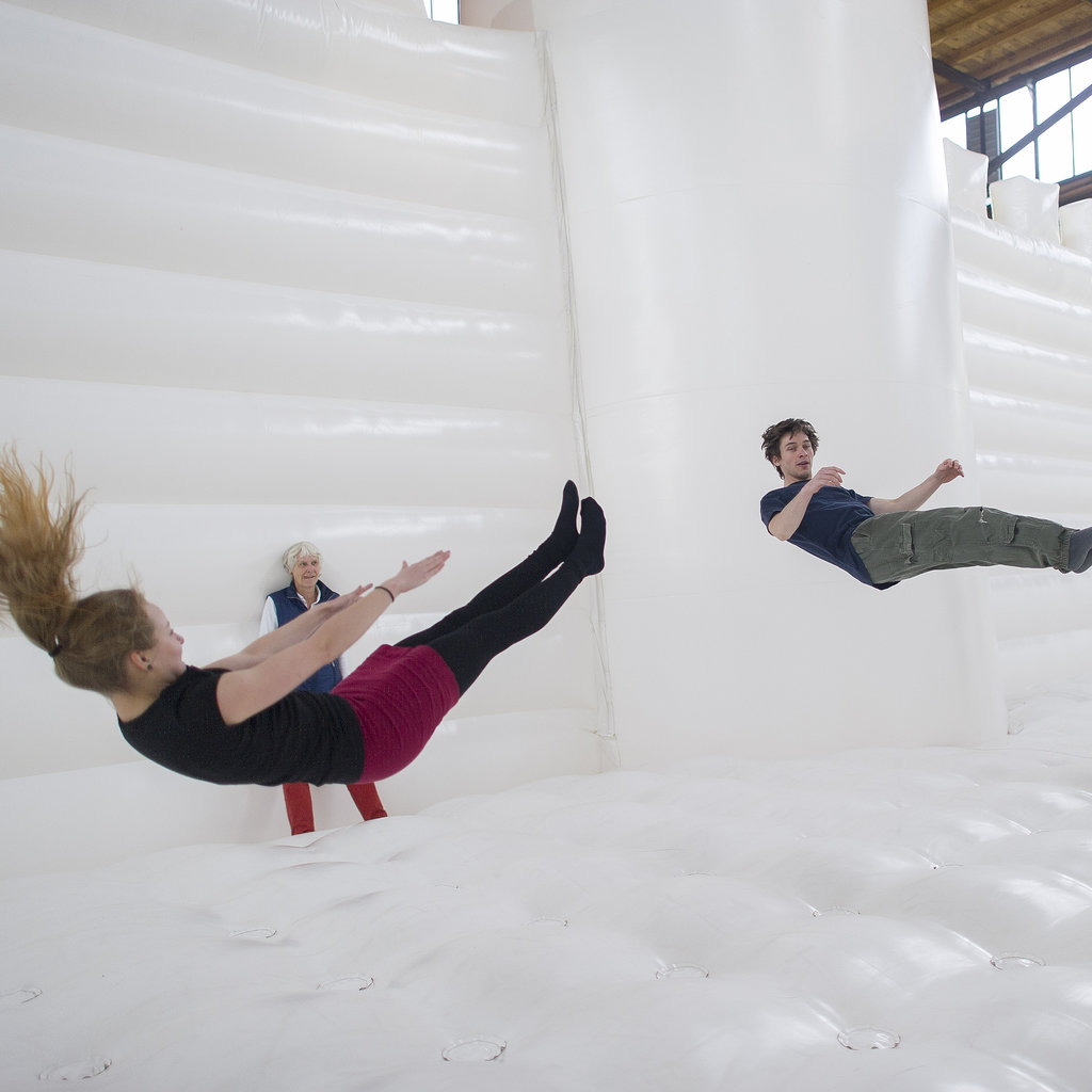 "Visitors jumped in artist William Forsythe's ""White Bouncy Castle"" art installation in Berlin, Germany."