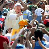 In Italy's St. Peter's Square, Pope Francis waved to the crowd as he arrived in the Popemobile.