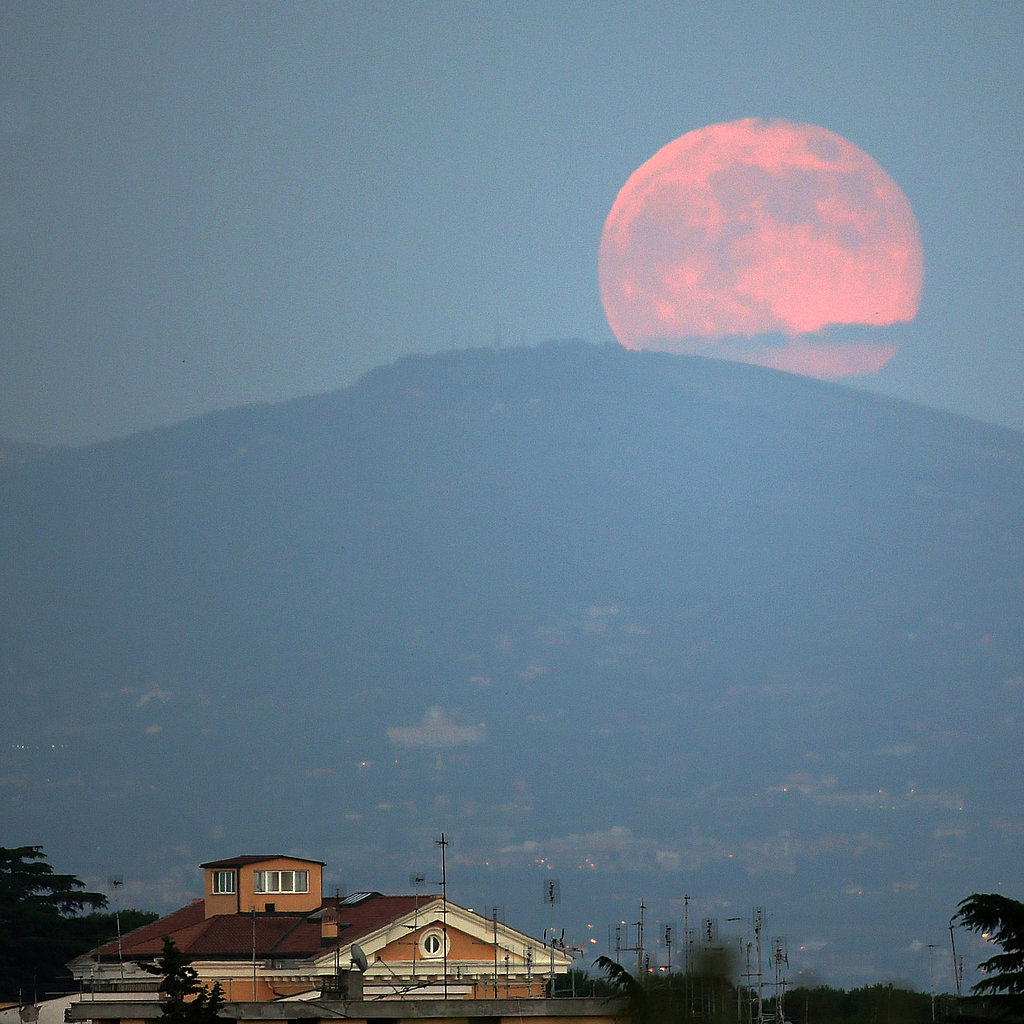 A pink moon sat over Rome, Italy — an occurrence that happens yearly when the moon is closest to Earth.