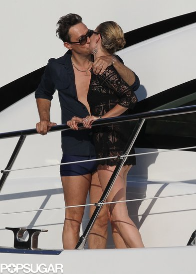 Jamie Hince and Kate Moss shared a steamy kiss on the deck of Sir Philip Green's yacht during their July 2011 honeymoon in Corsica, France.