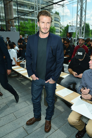 David Beckham wore a t-shirt and a blue jacket.