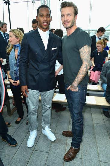 David Beckham chatted with Victor Cruz at the Louis Vuitton Menswear Spring/Summer 2014 show.