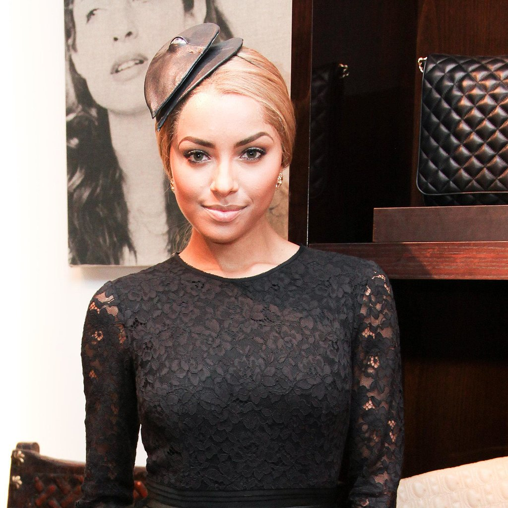 We're fascinated with Kat Graham's fascinator, blond updo, and simple smoky eye.