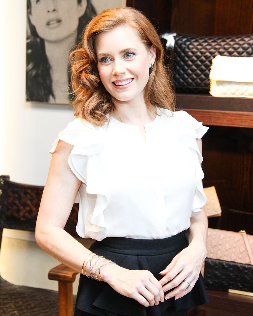 A head full of glamorous curls and neutral makeup made for a beautiful look on Amy Adams.