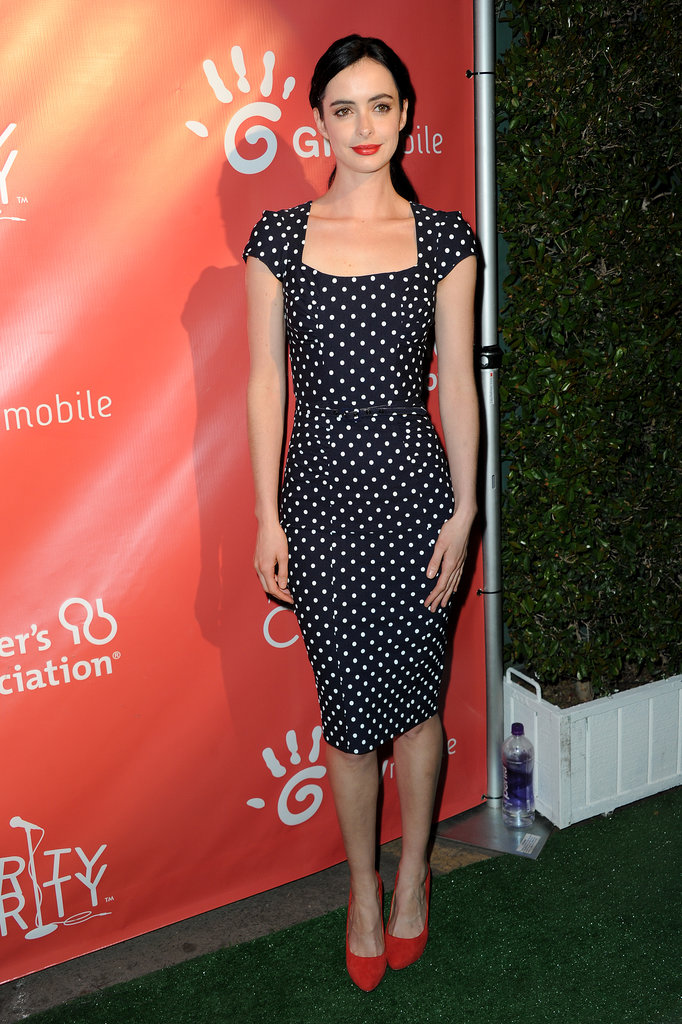 For a touch of retro, opt for a navy-and-white polka-dot dress and red pumps like Krysten Ritter's ensemble.