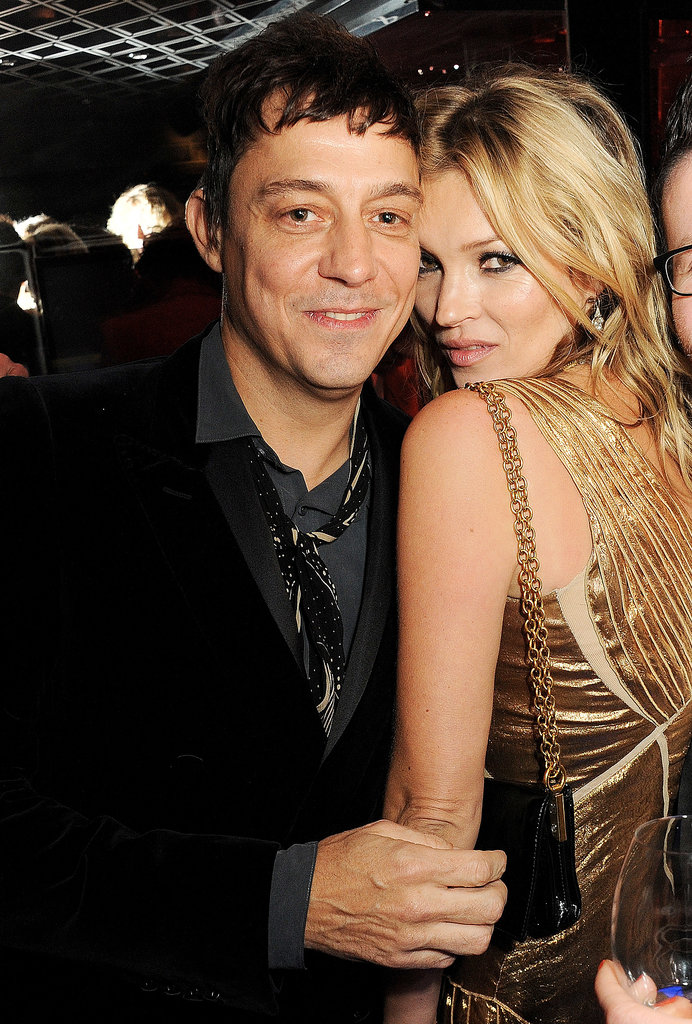 Kate Moss stayed close to Jamie Hince at the launch of her photography tome Kate: The Kate Moss Book in London in November 2012.