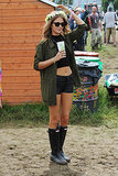 The UK's tricky weather means wily styling, like Made in Chelsea's Millie Mackintosh's mix of crop top, shorts, parka, and galoshes. And a flower crown, because it's a music festival, after all.
