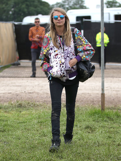 Cara Delevingne anchored her bright bomber and mirrored sunglasses with black skinnies and a dark shoulder bag.