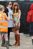 Another outing, another outfit for Florence Welch, who forwent wellies for knee-high boots and a bright minidress.