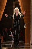 Donatella Versace takes a bow at Atelier Versace Haute Couture Fall 2013.