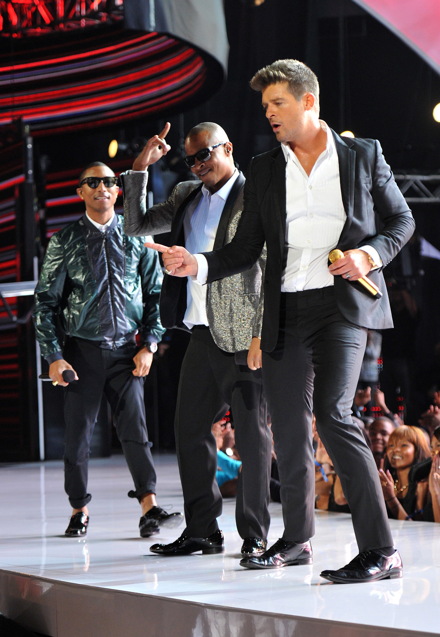 Pharrell Williams and T.I. performed with Robin Thicke.