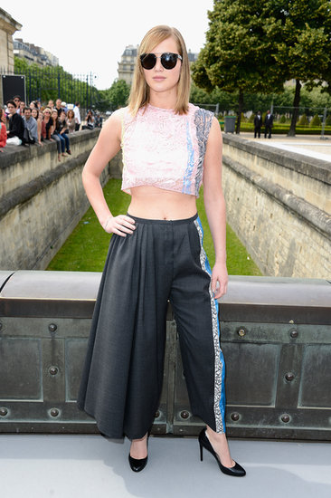 Jennifer Lawrence showed off her stomach on her way to the Christian Dior show in Paris. See which other stars sat front row at Paris Haute Couture.