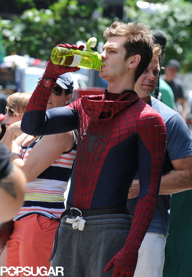 Andrew Garfield hydrated between filming in his Spider-Man suit in NYC.