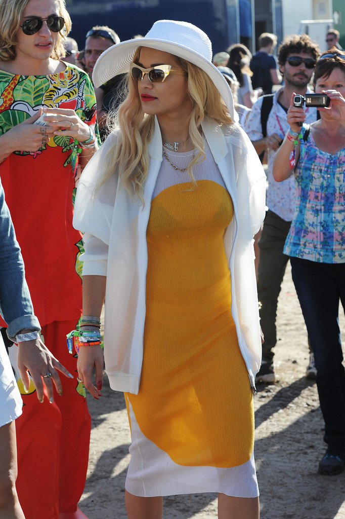Another day, another fierce look from Rita Ora, who accented a bold orange and white sheath dress with a floppy hat and extreme cat-eye sunglasses from Topshop.