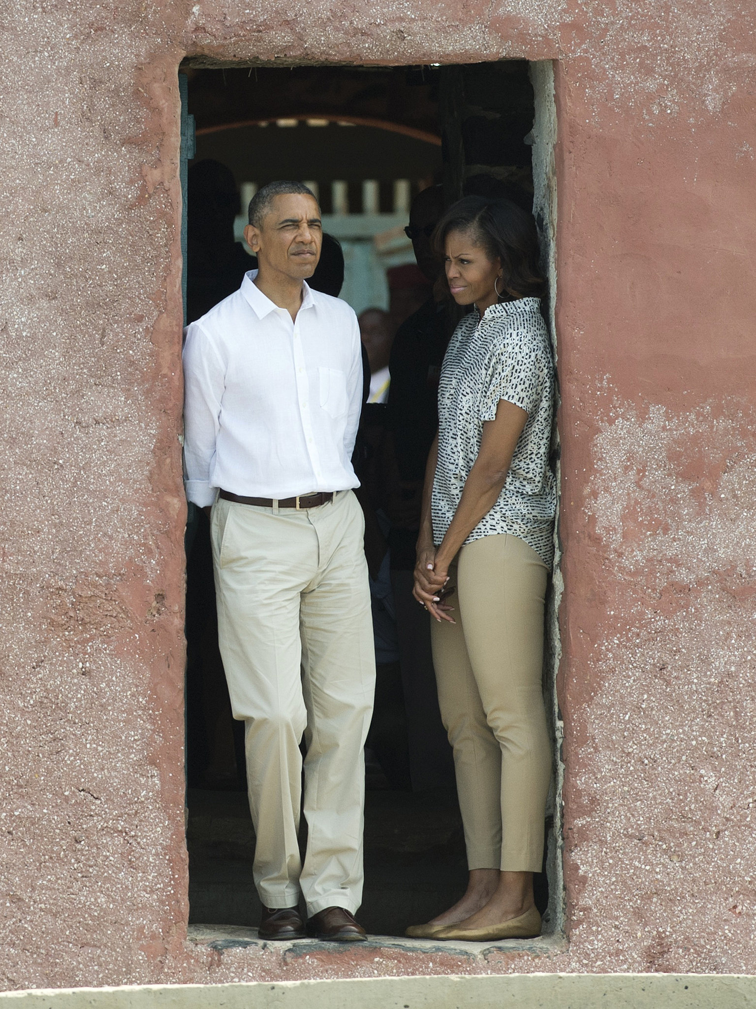 The first lady was laid-back but undeniably put-together in khaki cropped trousers and a printed blouse while visiting the Door of No Return in Dakar with the president.