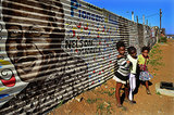 Children walked near a mural of Nelson Mandela in Johannesburg, South Africa.