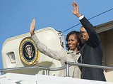 The Obamas waved from Air Force One as they left Pretoria, South Africa, in June.