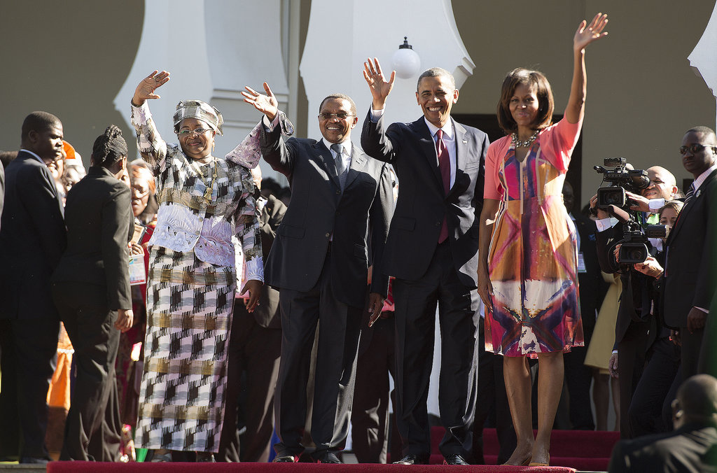 In Tanzania, the Obamas waved alongside Tanzanian President Jakaya Kikwete and First Lady Mama Salma Kikwete in July.