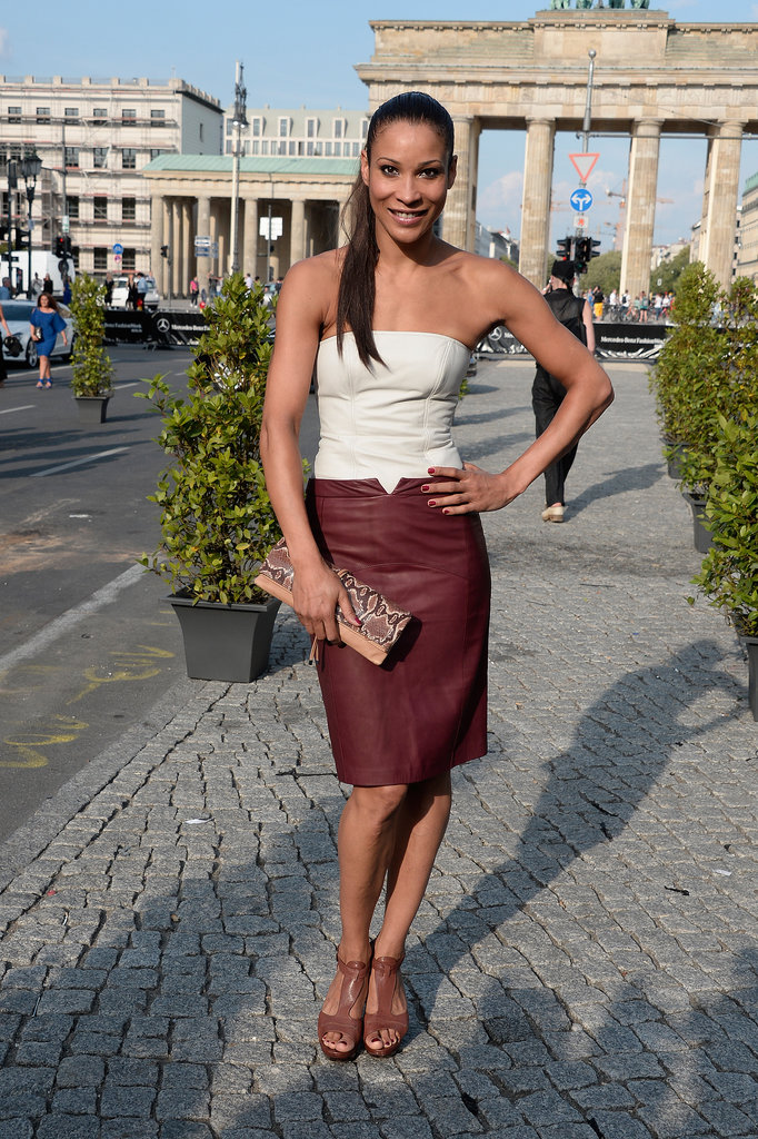 A great mix of two leather pieces: a white strapless bustier and a dark red pencil skirt.