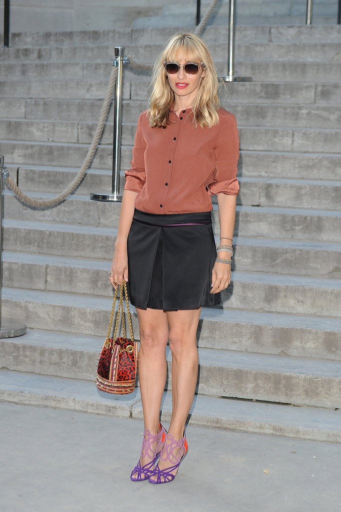 The everyday work uniform was made over for the fashion set with purple and pink heels, a leopard bag, and an artfully cuffed and tucked silk button-up.