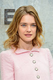 Model Natalia Vodianova sat front row at Chanel with barely-there makeup, save for a touch of soft pink lip color. She complemented the natural look with loose waves.