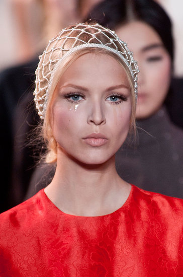 Tears streamed down the faces of Ulyana Sergeenko's models; otherwise, the look was focused on the doll-like lashes.