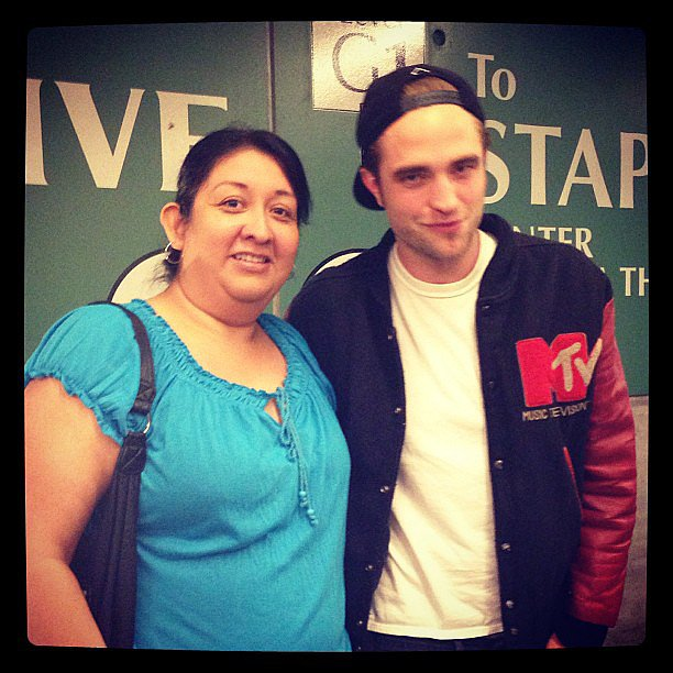Robert Pattinson posed with a fan outside of Beyoncé Knowles's LA show. Source: Instagram user fallen_star1
