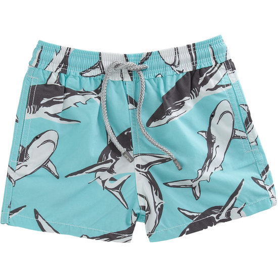 Your little lover of luxury can hit the beach in style in Vilebrequin's Shark Print Swim Trunks ($160).