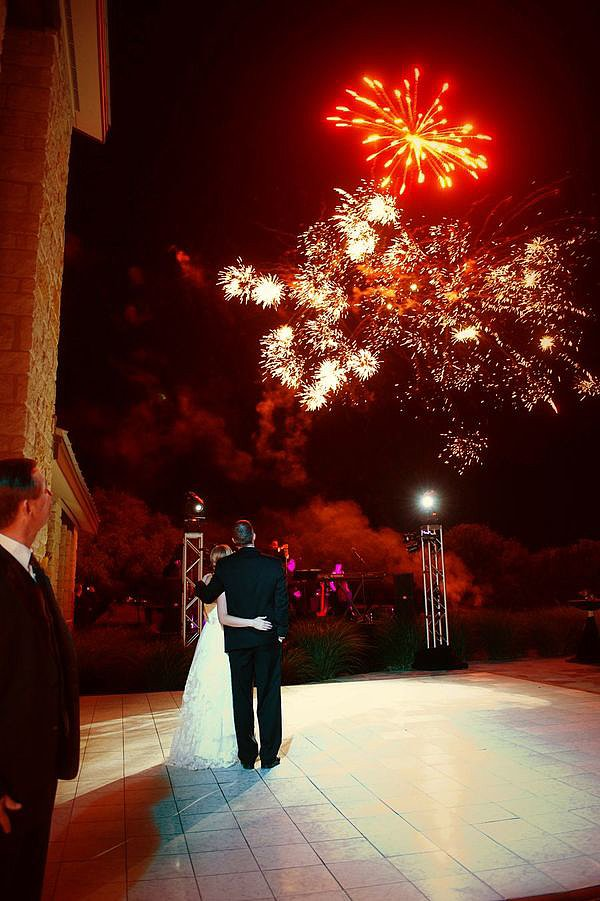 Red and white lit up the sky at this big day in Texas Hill Country. Photo by J. Cogliandro Photography via Style Me Pretty