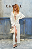 Rihanna wore not much more than a long cardigan to the Chanel show on Tuesday.
