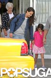 Katie Holmes held on to Suri Cruise as they arrived in NYC.