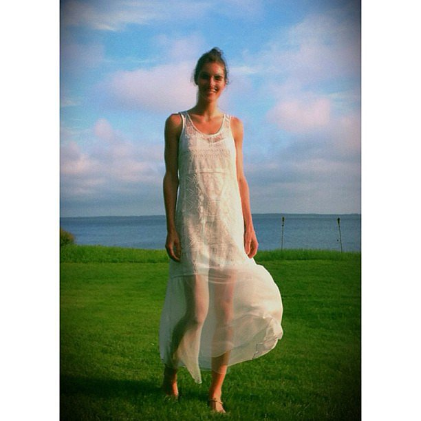Hilary Rhoda shared a dreamy snap while on holiday — how pretty is that billowy white dress? Source: Instagram user hilaryhrhoda