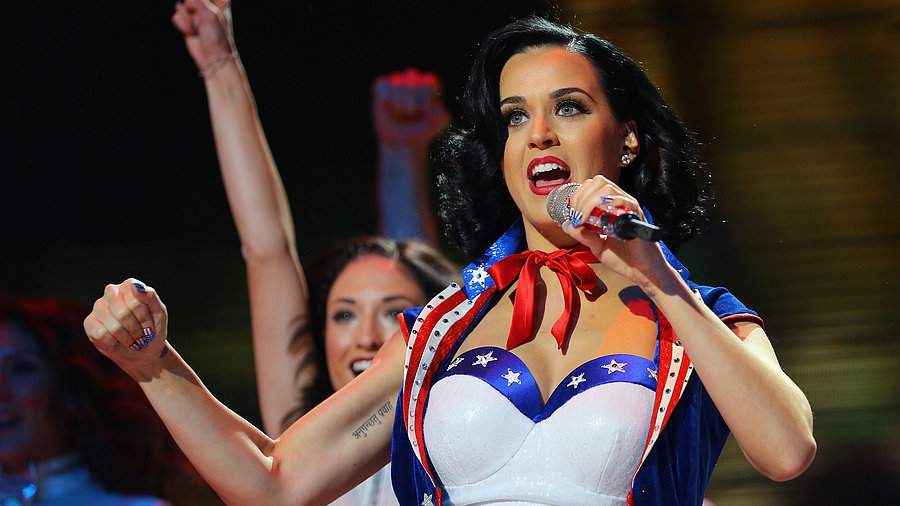 Video: What Do Whitney Houston, Katy Perry, and Ben Affleck Have in Common? Stars Celebrating the USA!