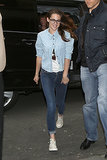 Kristen Stewart did denim on denim in Paris. Do the same by sporting a chambray button-down with dark blue skinny jeans and white Converse sneakers.