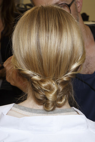 The back of the hair at Valentino was just as eye-catching as the front, with strands styled into intricately twisted chignons.