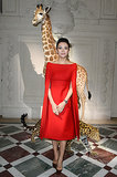 Zhang Ziyi looked polished in a red dress she wore to the Valentino Couture show in Paris.