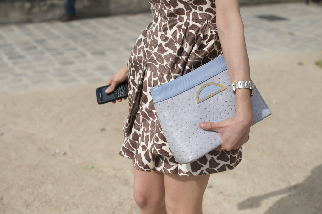 An oversize Dior clutch is made instantly better with this cool shade of lavender.