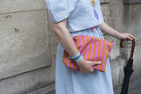 A striped clutch played right off her sweet, printed style.