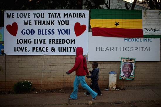 Signs line the wall outside the Pretoria hospital where Mandela is being treated.