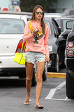 Alessandra Ambrosio punched up her denim cutoffs with a bright coral sweatshirt, a neon yellow Michael Michael Kors bag, and mirrored sunglasses in LA.