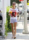 Alessandra tucked a Hendrix tee into striped denim cutoffs during a coffee run in LA.