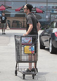 Robert Pattinson pushed his cart to his car in LA.