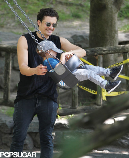Orlando Bloom pushed his son, Flynn, on the swing.