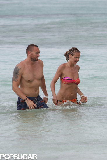 Heidi Klum frolicked in the ocean with her boyfriend, Martin Kristen.