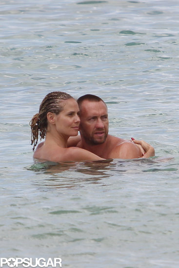 Heidi Klum showed PDA with her boyfriend, Martin Kristen, in the Bahamas.