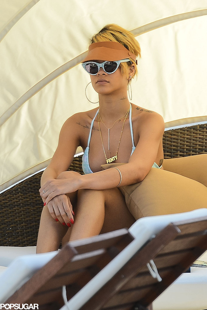 Rihanna Pops Up in Poland Rocking Fishnets and a Bikini